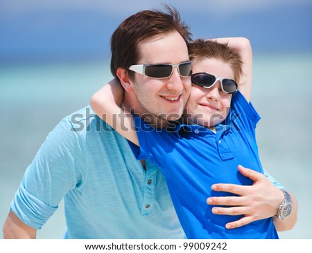 Portrait of happy father and son on summer vacation - stock photo