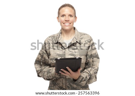 Portrait of happy female airman with digital tablet against white - stock photo