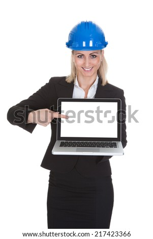 Portrait Of Happy Female Architect Holding Laptop Over White Background - stock photo