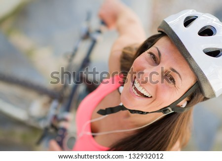 Portrait Of Happy Female Cyclist, Outdoors - stock photo