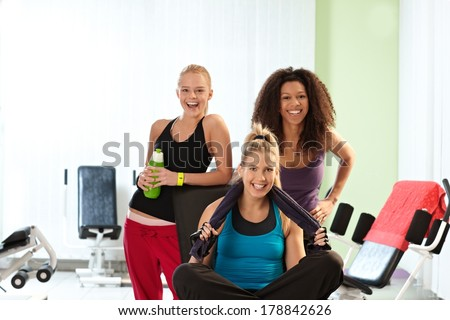 Portrait of happy fit girls at the gym. - stock photo