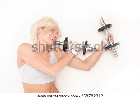 portrait of Happy fitness woman lifting dumbbells smiling cheerful, fresh and energetic. Caucasian fitness girl training isolated on white background - stock photo