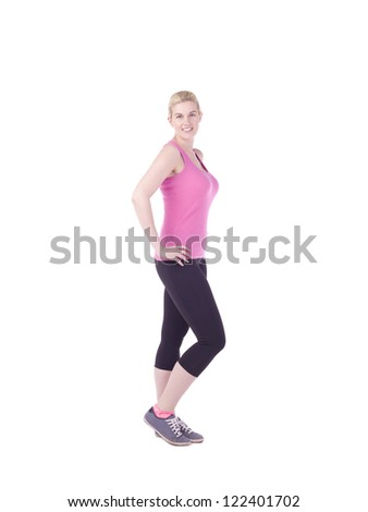 Portrait of happy fitness woman standing on a white surface