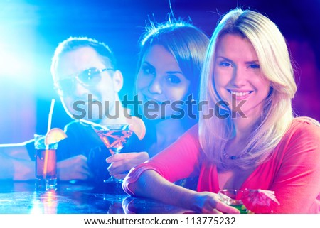 Portrait of happy friends having party in bar - stock photo
