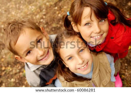 Portrait of happy friends looking at camera with smiles