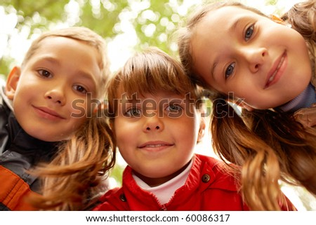 Portrait of happy friends looking at camera with smiles - stock photo