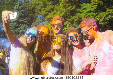 Portrait of happy friends on holi color festival making selfi - stock photo