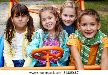 Portrait of happy friends spending time in park of recreations - stock photo