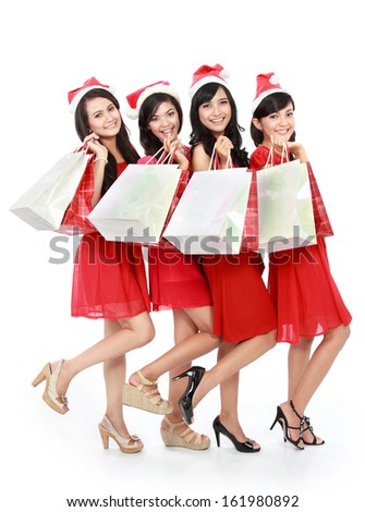 Portrait of happy funny people with christmas santa hat holding gift boxes - stock photo