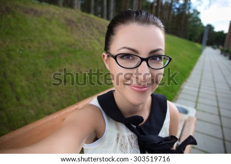 portrait of happy funny young woman making selfie photo - stock photo