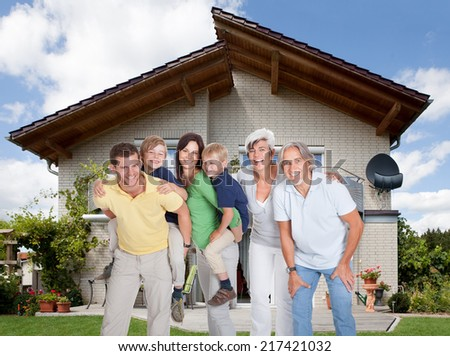Portrait of happy generations family In Front Of House - stock photo