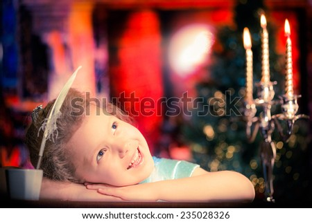 Portrait of happy girl against Christmas lights background - stock photo