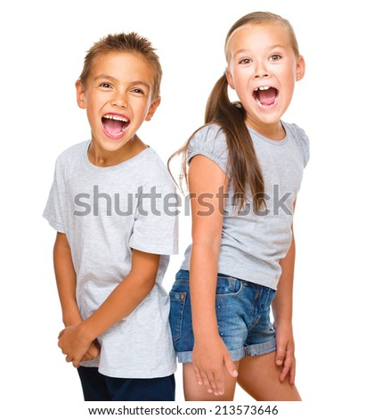Portrait of happy girl and boy, isolated over white