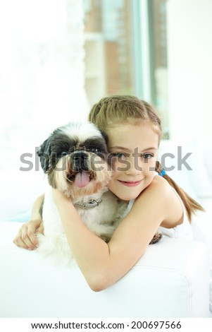 Portrait of happy girl and shih-tzu dog and looking at camera - stock photo
