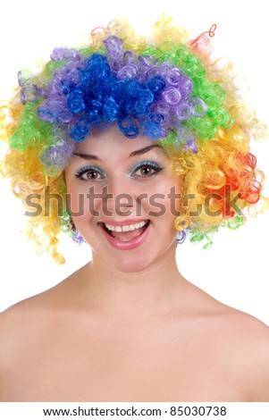 Portrait of happy girl in a colorful wig - stock photo