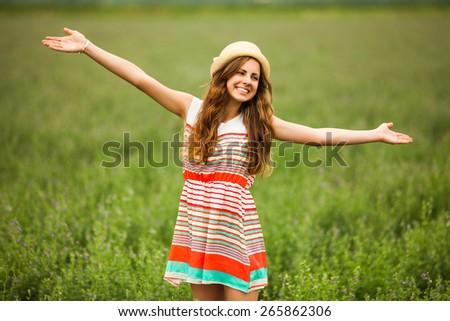 Portrait of happy girl in wheat field - stock photo