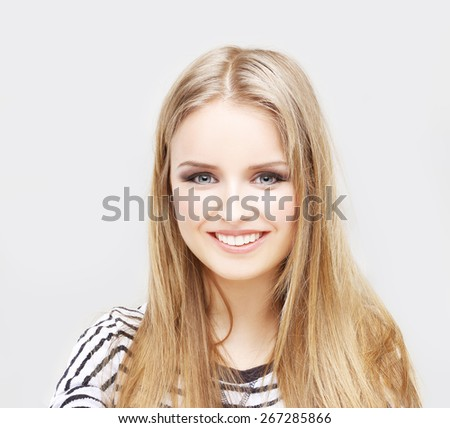 Portrait of happy girl ,  laughing at camera - stock photo