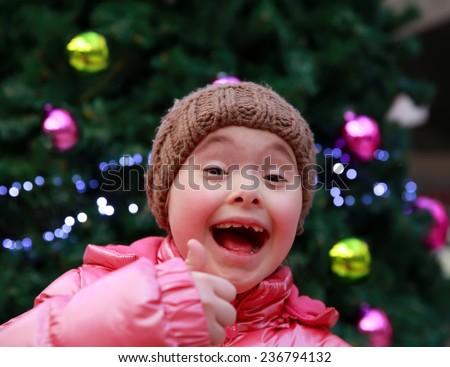 Portrait of happy girl on playground - stock photo