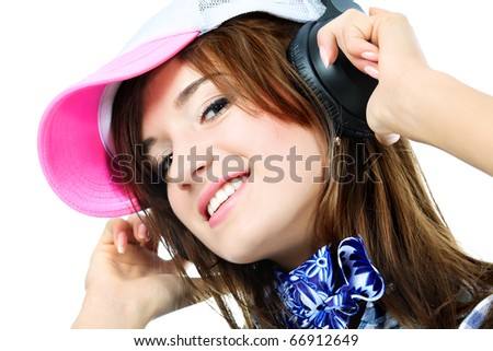 Portrait of happy girl with headphones. Isolated over white background.