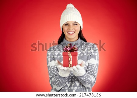 Portrait of happy girl with small red package looking at camera in isolation - stock photo