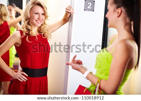 Portrait of happy girls interacting in clothing department - stock photo