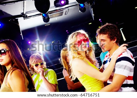 Portrait of happy glamorous friends during party in a night club - stock photo
