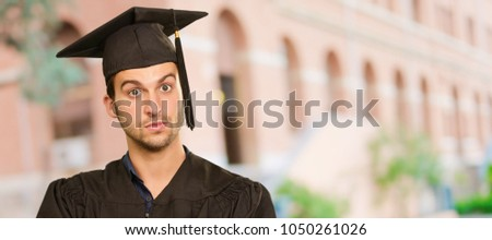 Portrait Of Happy Graduate Man, Outdoors