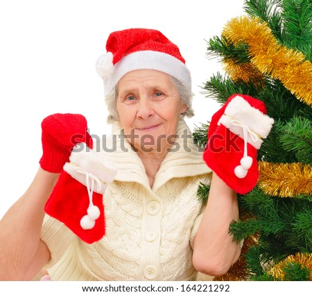 Portrait of happy grandma in Santa cap decorating Christmas tree on white background - stock photo