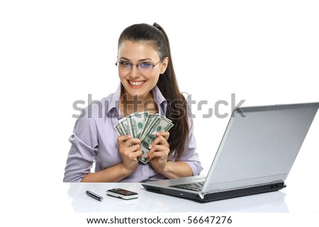 Portrait of happy greedy for money woman with a fan of American dollar using laptop - stock photo