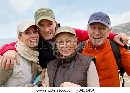 Portrait of happy group of hikers - stock photo