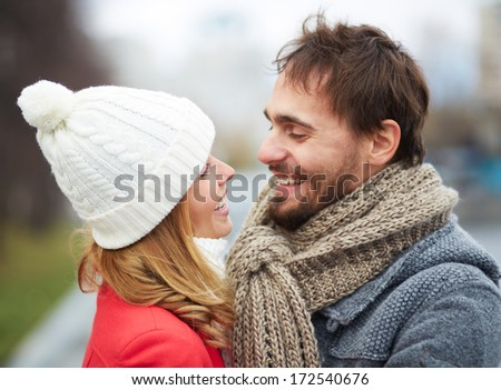 Portrait of happy guy and his girlfriend looking at one another - stock photo