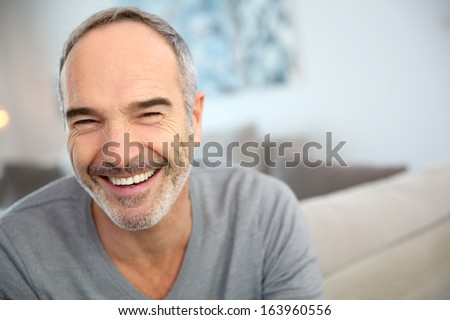 Portrait of happy handsome mature man - stock photo