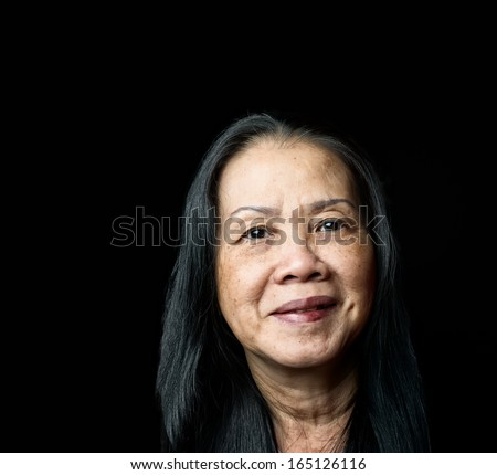 Portrait of happy, healthy elderly lady smiling. - stock photo