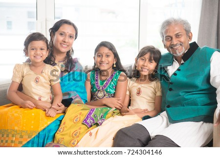Portrait of happy Indian family at home, smile at camera.
