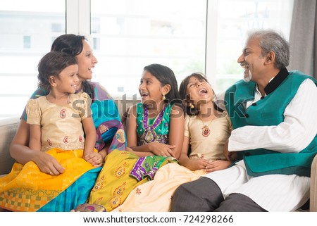Portrait of happy Indian family bonding at home.