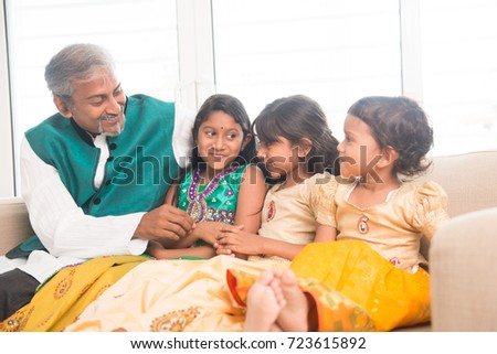 Portrait of happy Indian family bonding at home. Asian father and children indoors lifestyle.