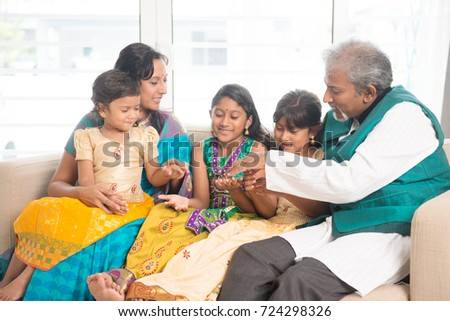 Portrait of happy Indian family having fun at home. Asian people indoors lifestyle.