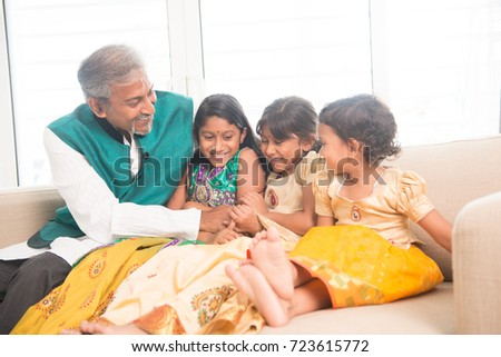 Portrait of happy Indian family playing at home. Asian father and children indoors lifestyle.