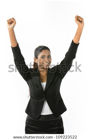 Portrait of happy Indian woman celebrating with her arms in the air. Isolated on a white background. - stock photo