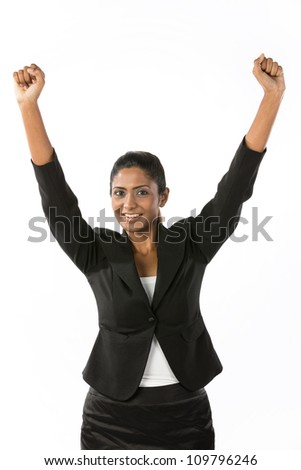Portrait of happy Indian woman celebrating with her arms in the air. Isolated on a white background.