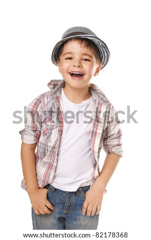 Portrait of happy joyful beautiful stylish little boy in hat isolated on white background - stock photo
