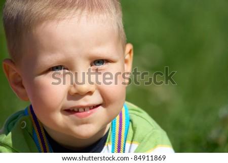 Portrait of happy joyful  little boy in summertime - stock photo