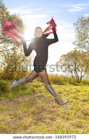 Portrait of Happy Jumping Young Caucasian  Blond Woman Outside. Shot Ising Strobe Light On Location. Vertical Image - stock photo