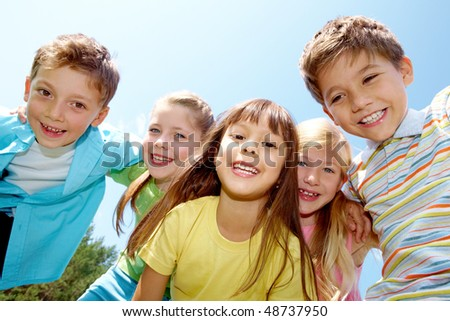 Portrait of happy kids representing youth and fun - stock photo