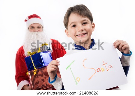 Portrait of happy lad showing his letter to Santa with the latter at background - stock photo