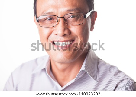 Portrait of happy leader wearing glasses and looking at camera - stock photo
