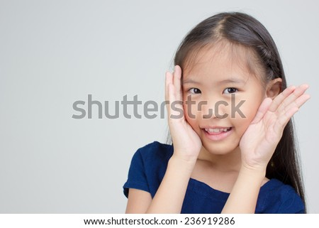 Portrait of happy little Asian child