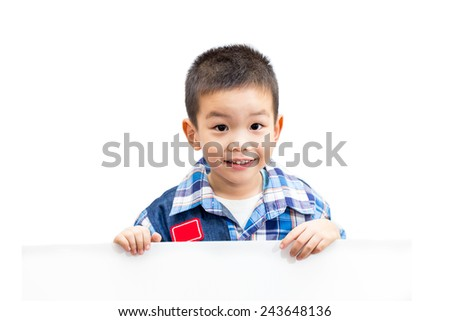 Portrait of happy little boy standing and holding empty white board isolated on white background - stock photo