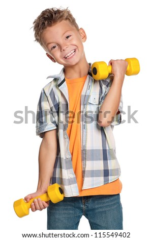 Portrait of happy little boy with dumbbells isolated on white background - stock photo