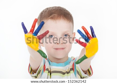 Portrait of happy little boy with paints on hands isolated on white background